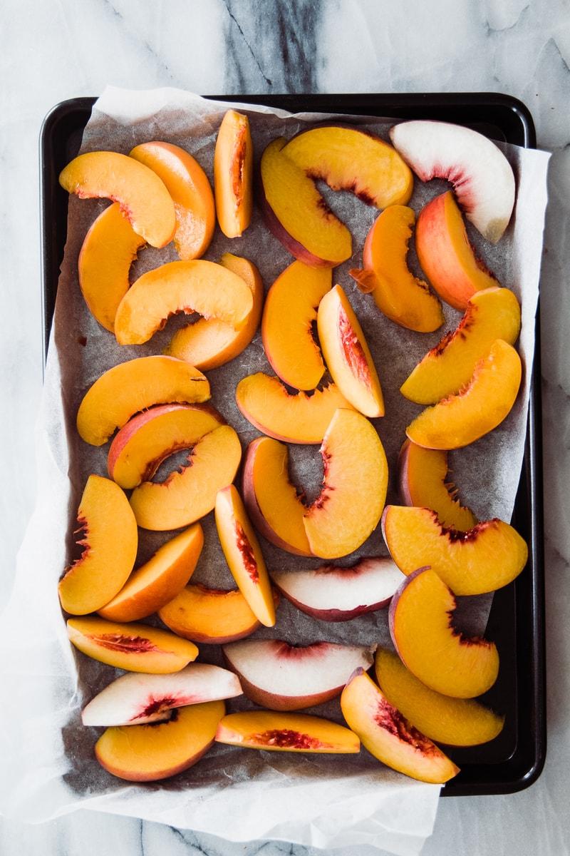 sliced peaches on a tray
