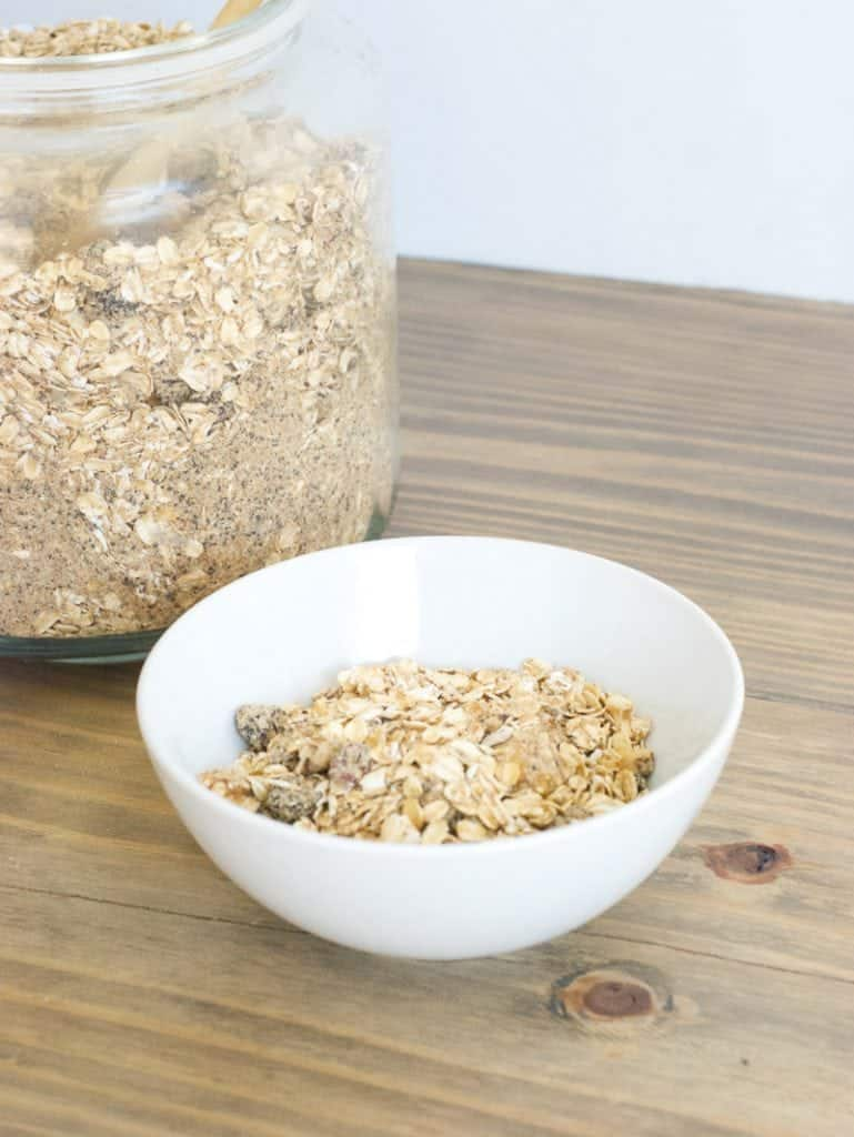 Fruit and Nut Oatmeal Mix in a large glass container and some in a white bowl