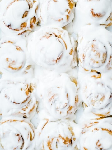 zoomed shot of frosted cinnamon rolls