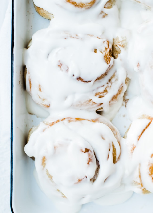 two cinnamon rolls frosted