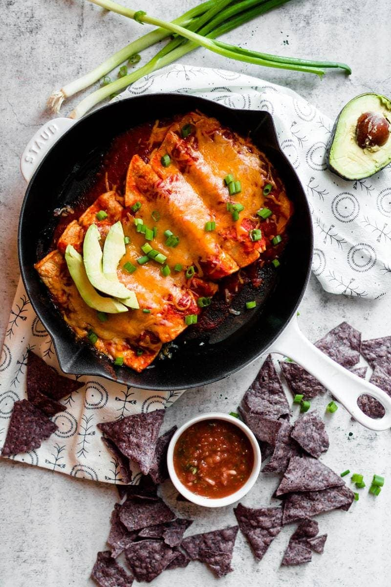 Enchiladas with Homemade Red Enchilada Sauce in cast iron skillet