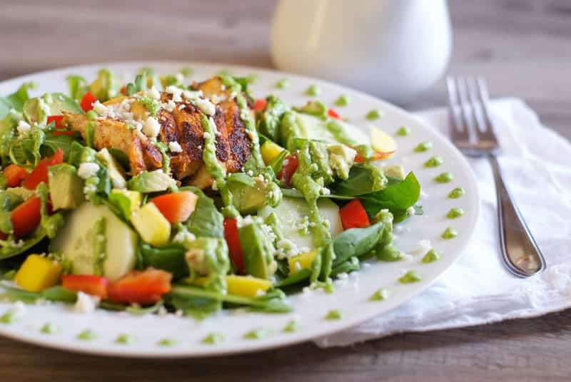 Cilantro Poblano Dressing drizzled on a spicy chicken salad