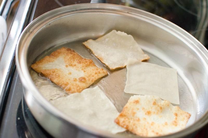 Won Tons frying in pan