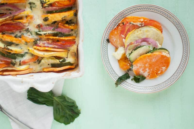 A sweet potato tian in a baking dish and some on a plate