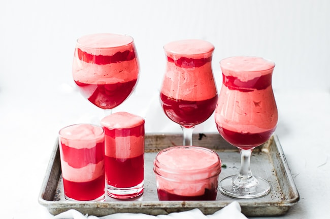 cups with light and dark red jello layers
