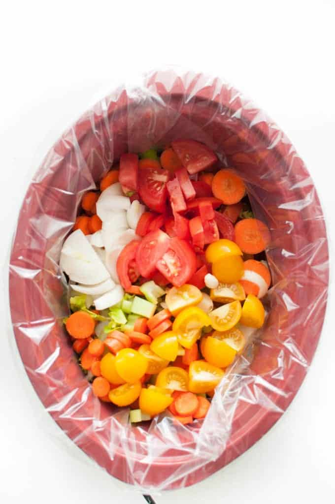 chopped veggies in a slow cooker