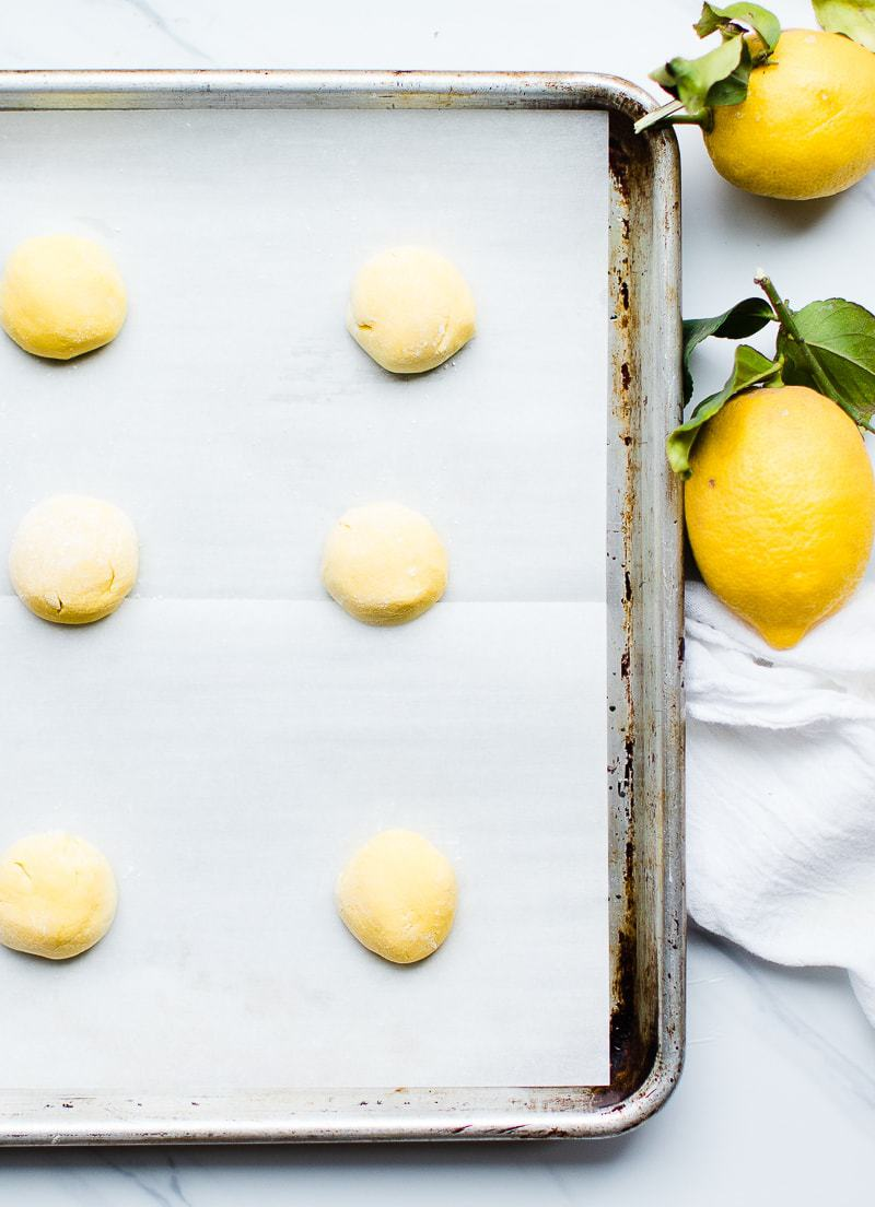 unbaked lemon cookies on a cookie sheet
