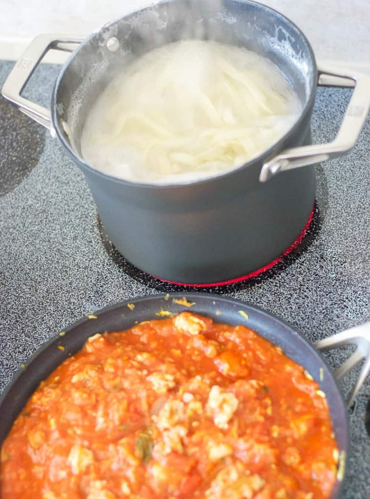 Hearty Pasta Sauce with Homemade Noodles cooking on stove
