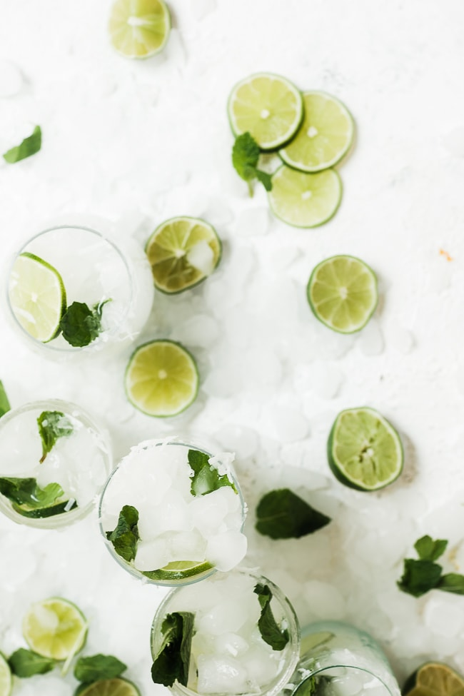Coconut Lime Spritzer Summer Mocktails on a countertop.