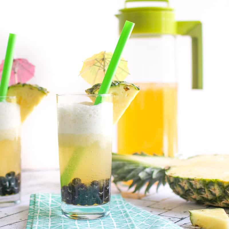 Coconut Pineapple Boba Tea in a glass with a straw