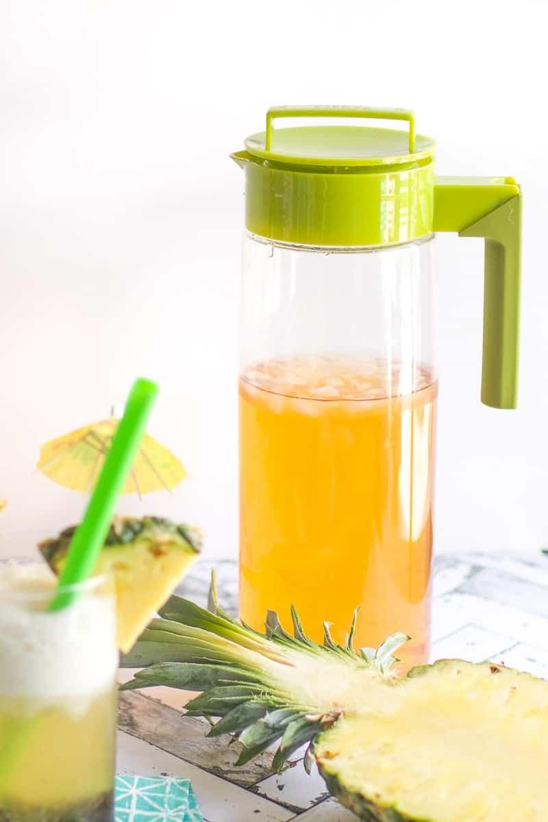 A large jug of pineapple coconut boba tea