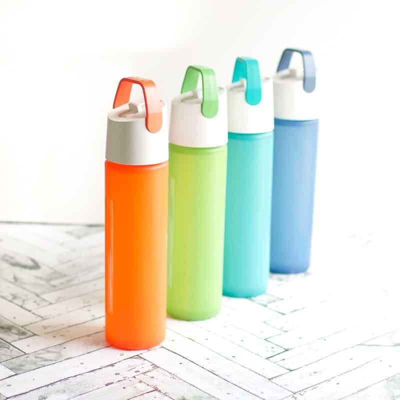 Takeya water bottles on a white surface