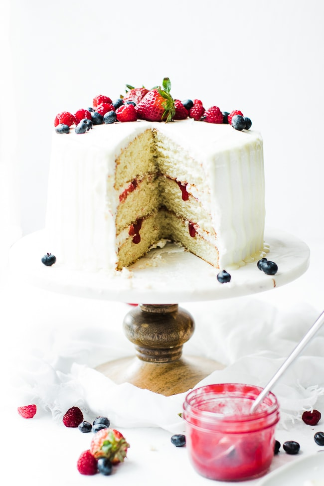 white layered cake with fresh fruit filling