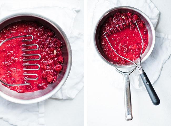 pan with potato smasher crushing berries