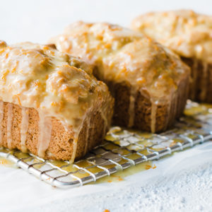Orange Mini Loaves on a wire cooling rack.