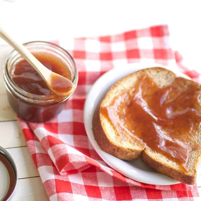 A close up of  Crockpot Apple Pear Butter spread on a slice of toast