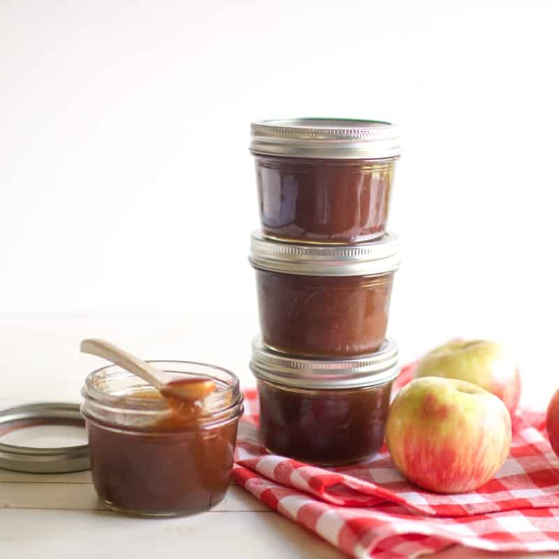 Three jars of  Crockpot Apple Pear Butter stacked on top of each other