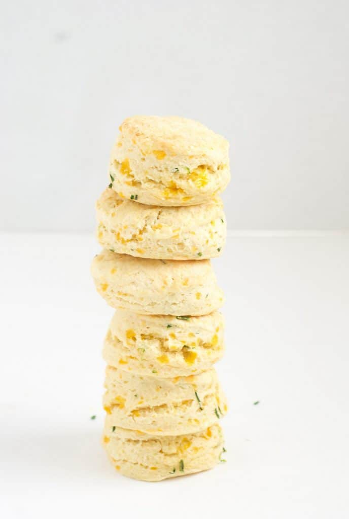 A stack of cheese biscuits on a white surface