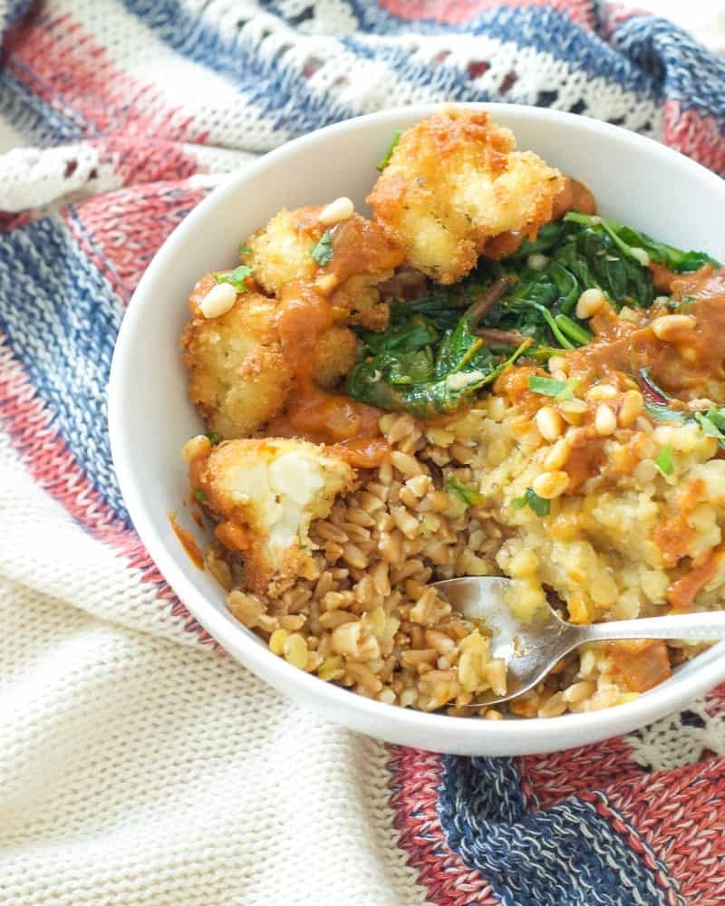 Lentil and Fried Cauliflower Curry Bowl on patterned cloth