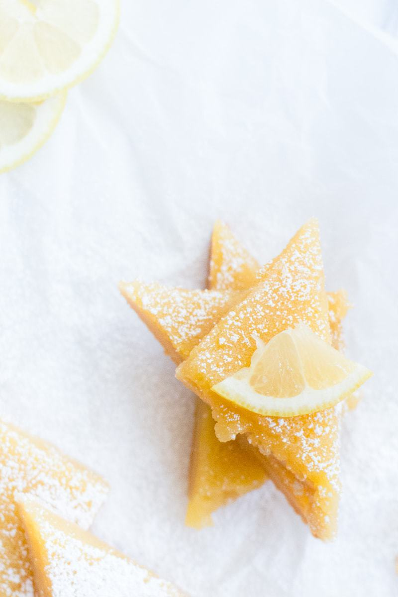 stacked lemon bars with powder sugar