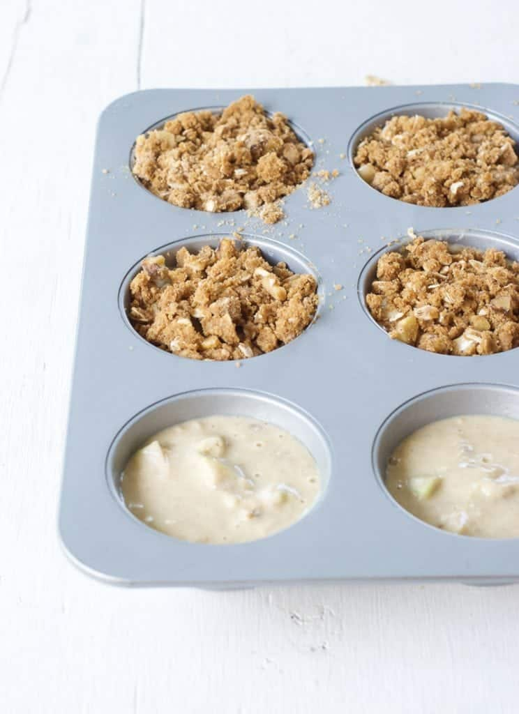 Cardamom Apple Muffins in a muffin tray ready to be baked