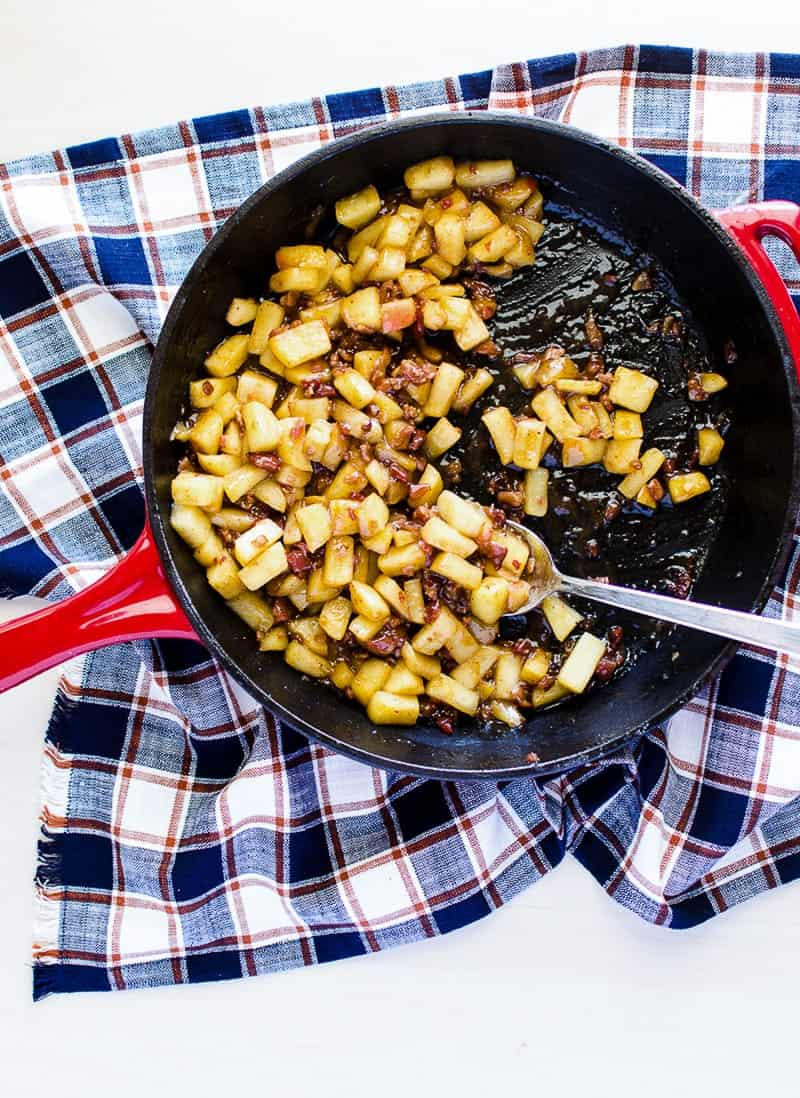 An overhead shot of Sautéed Apples with Bacon in a skillet