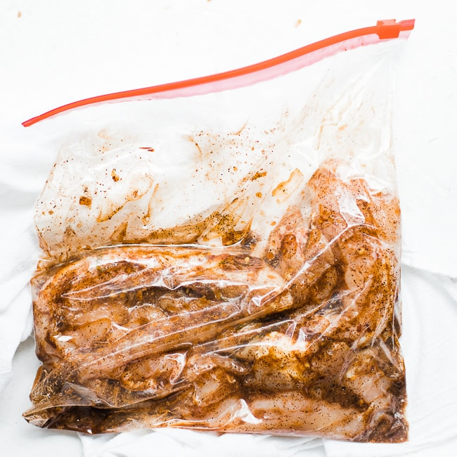 chicken marinating in a ziplock bag