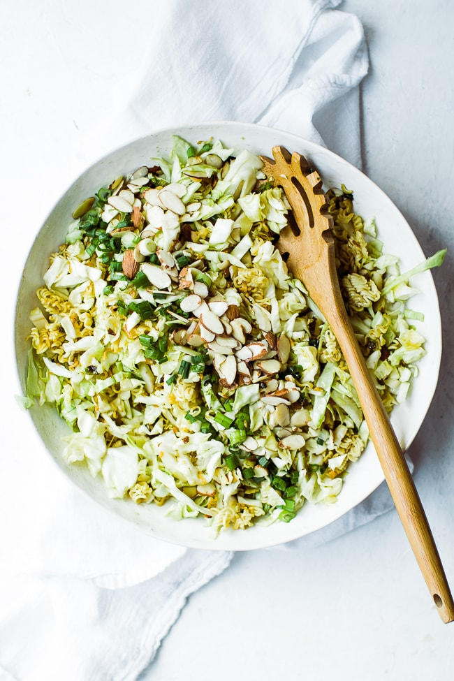 ramen noodle cabbage salad in bowl with spoon