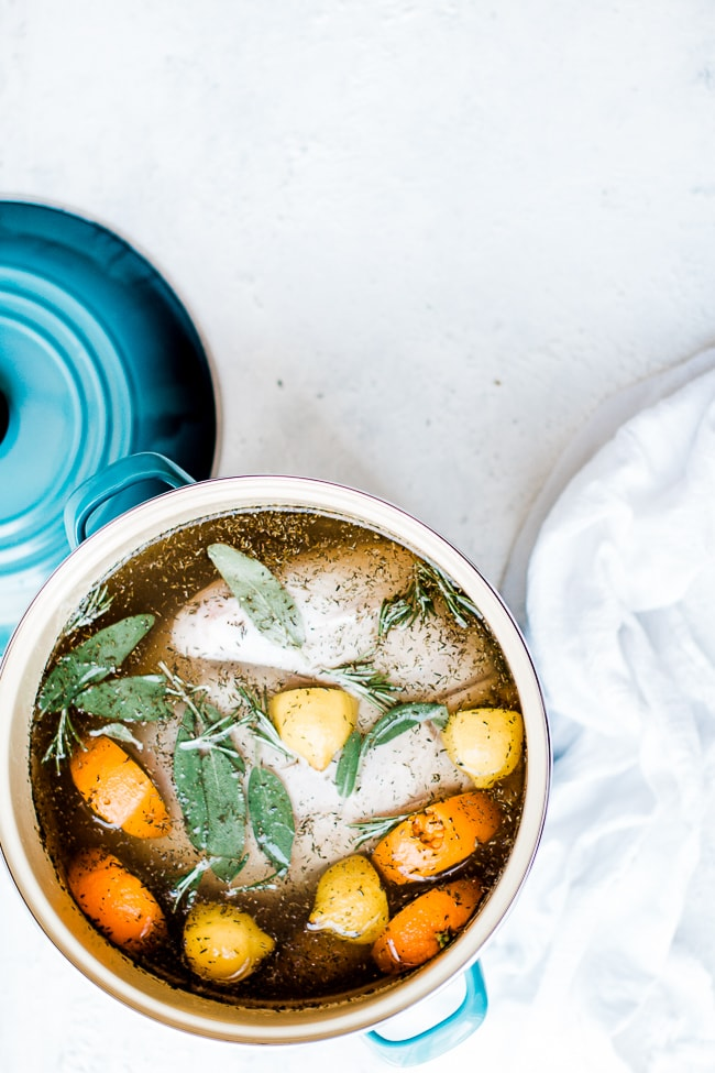 Citrus turkey brine in a turquoise stock pot.