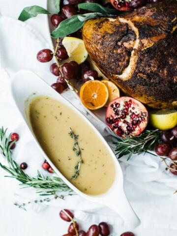 gravy in a gravy boat next to a turkey