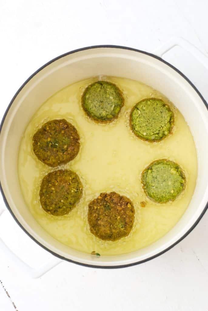 Falafel frying in oil
