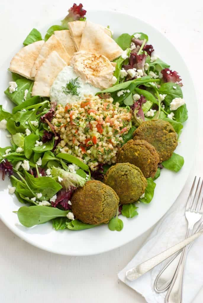 Falafel with Couscous Tabbouleh Salad on a white plate