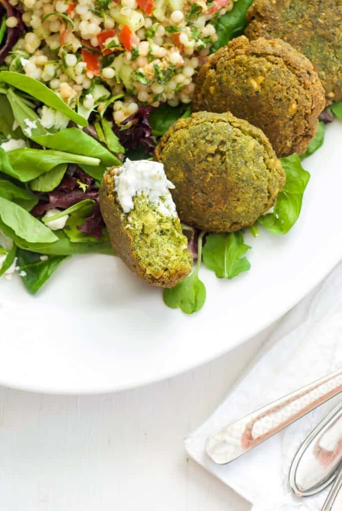 A close up of Falafel on a plate w with Couscous Tabbouleh Salad