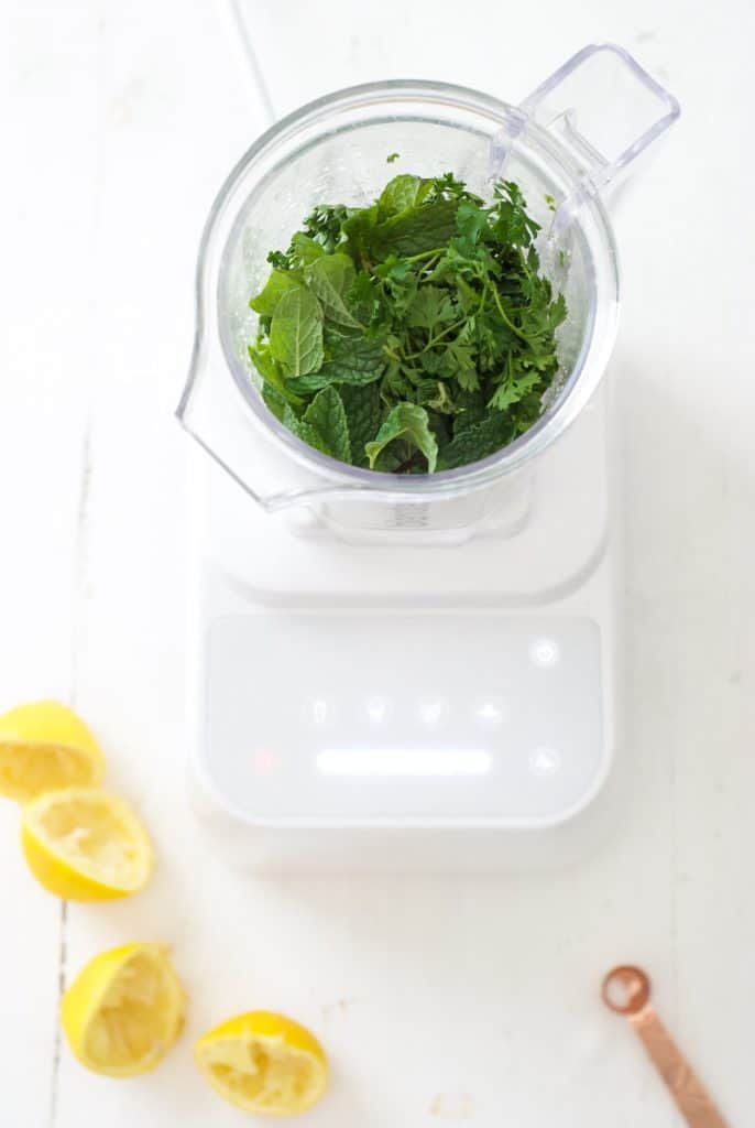 Green herbs in a food processor