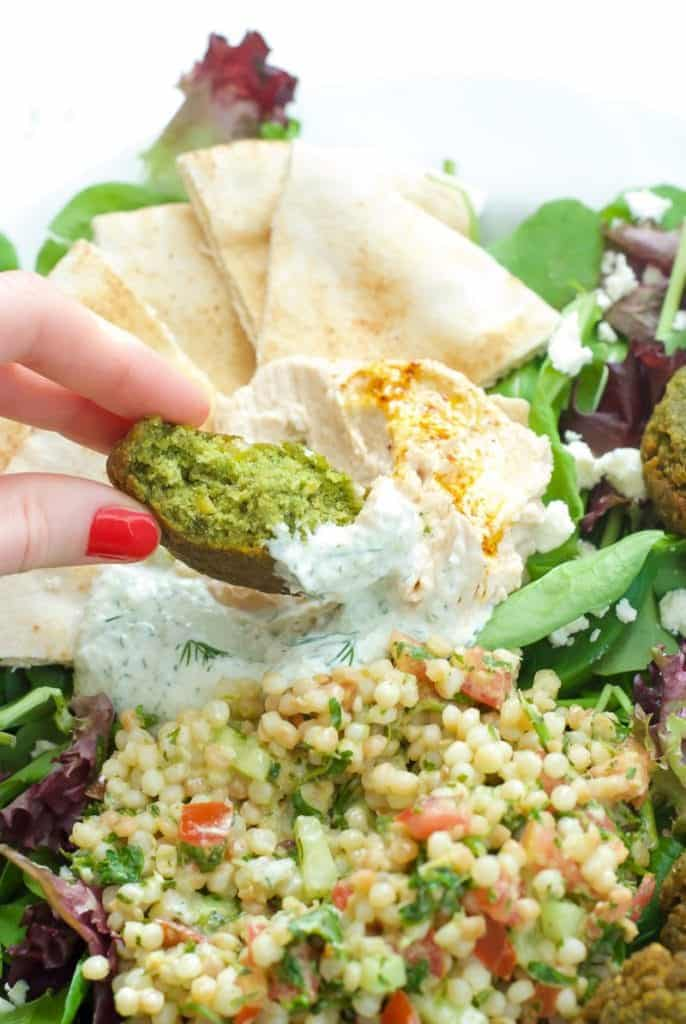 A close up of Falafel with Couscous Tabbouleh Salad