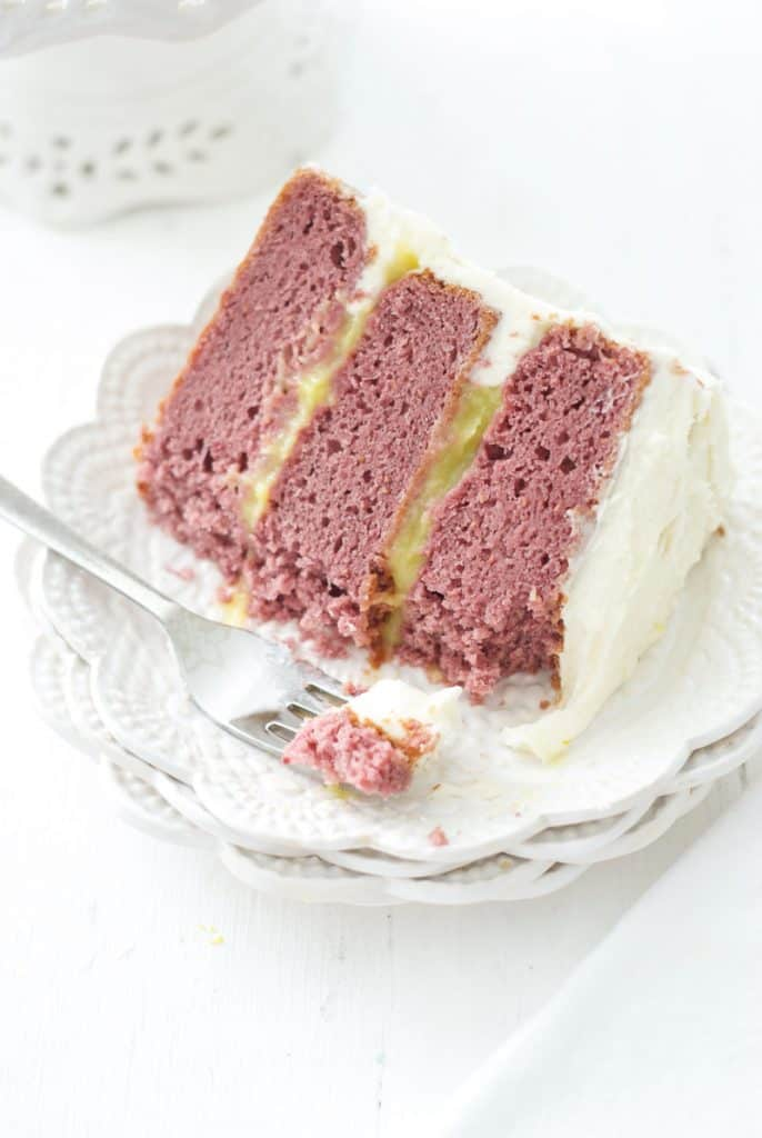 Piece of Raspberry Cake with Lemon Curd Filling and White Chocolate Icing