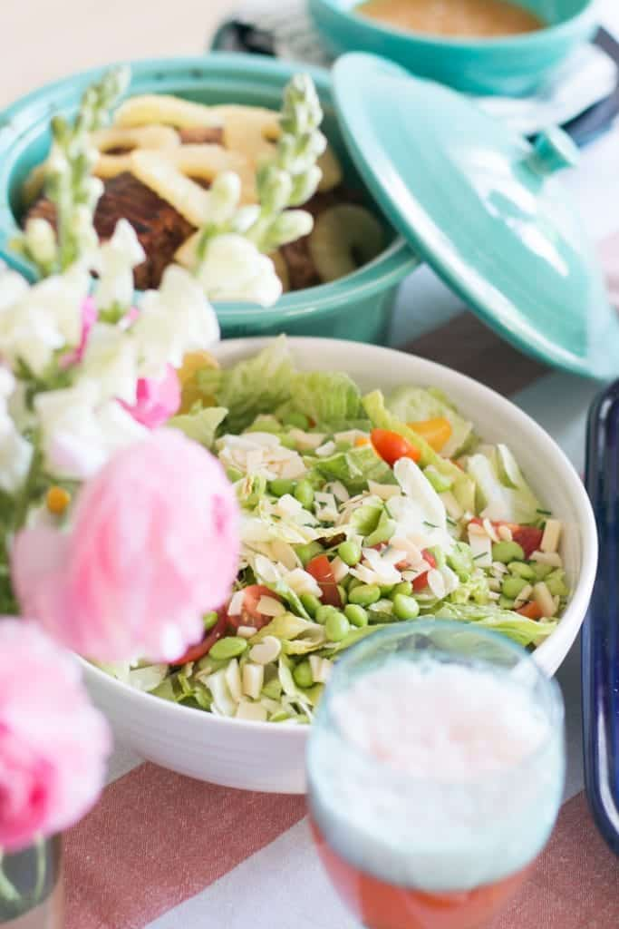 Lemon Swiss Cheese Salad with flowers on the table