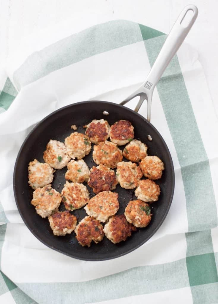 meatballs in pan on patterned cloth