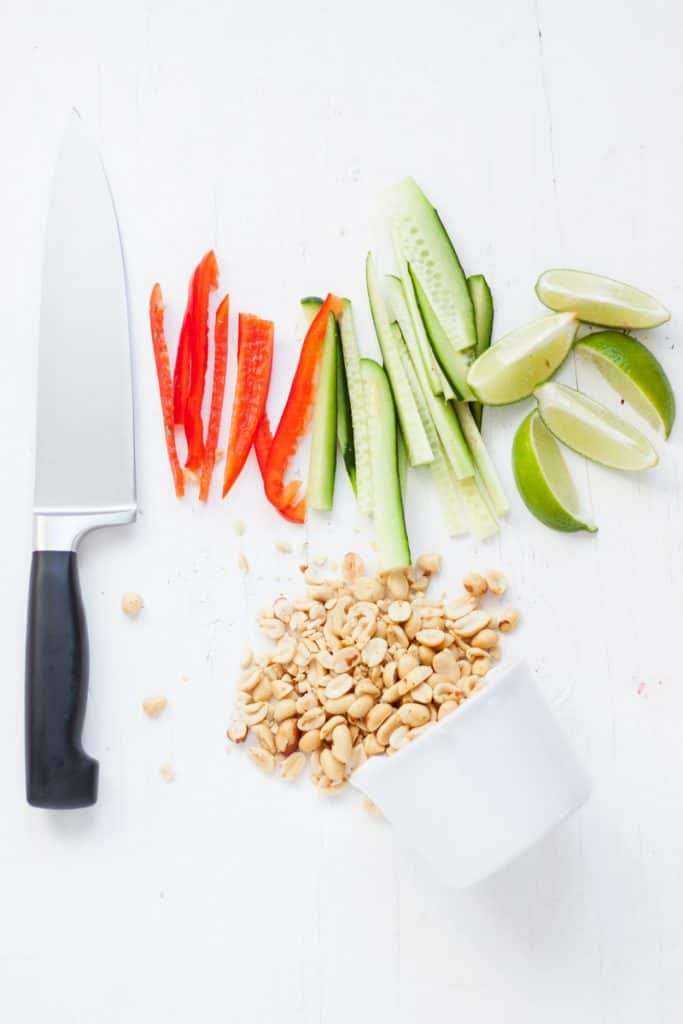 knife next to chopped vegetables for wraps