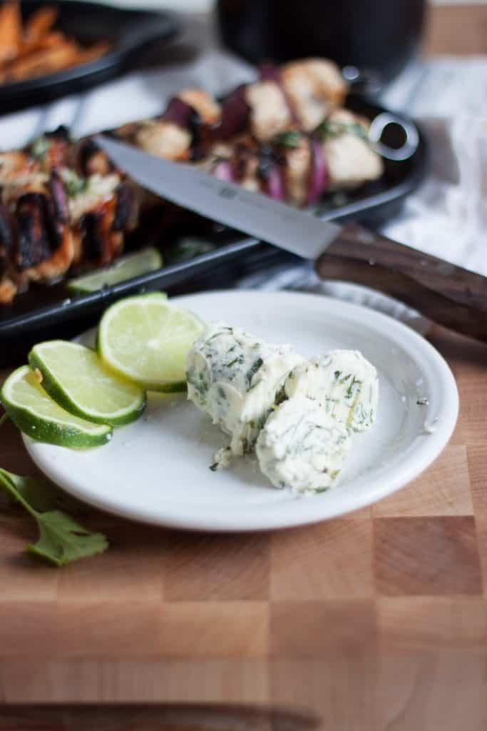 Cilantro Lime Butter on plate with halved limes