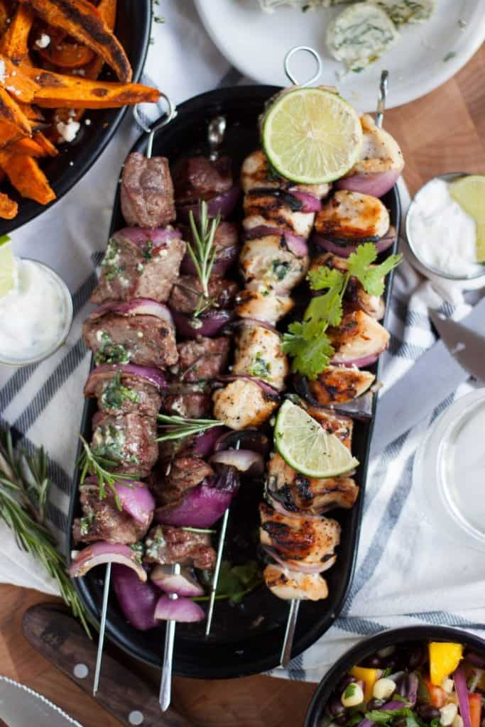 Cilantro Lime Butter Chicken Kabobs on platter with lime garnish