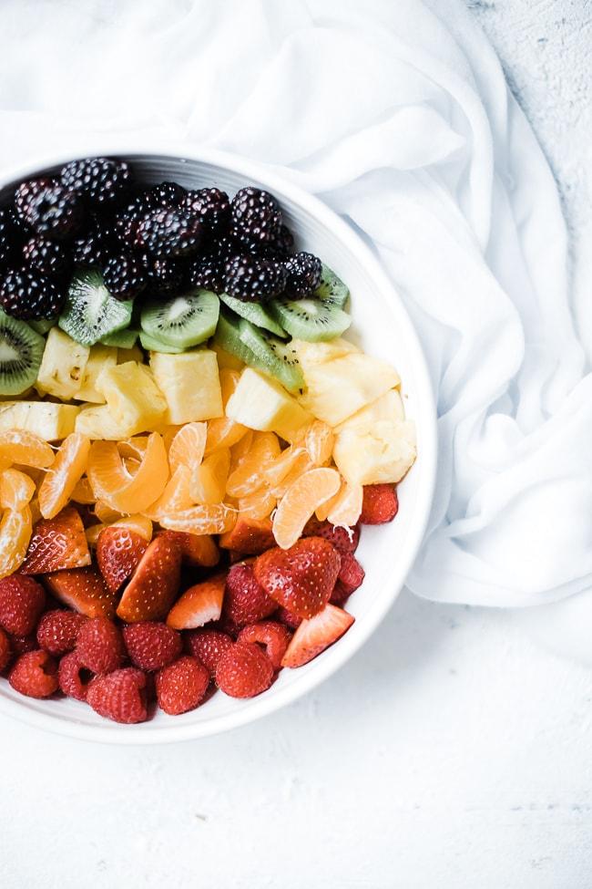 Mojito fruit salad ingredients - fruit separated.