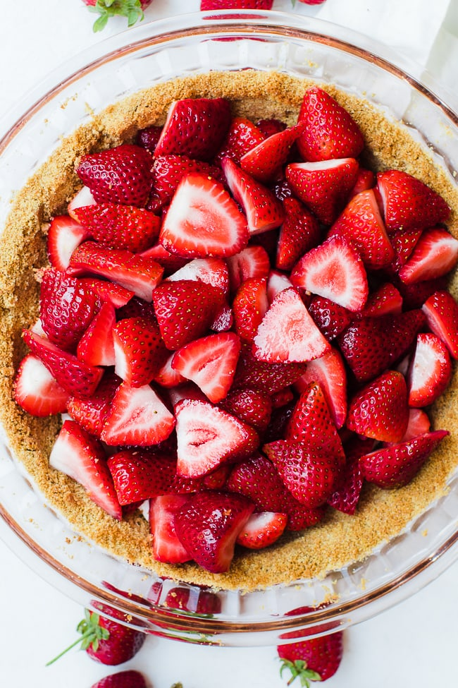 strawberries placed in pie crust