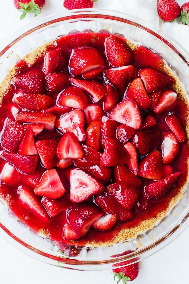 jello picture poured over strawberries