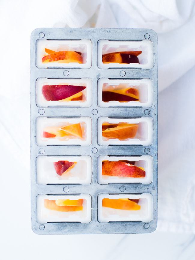 peach slices in popsicle mold