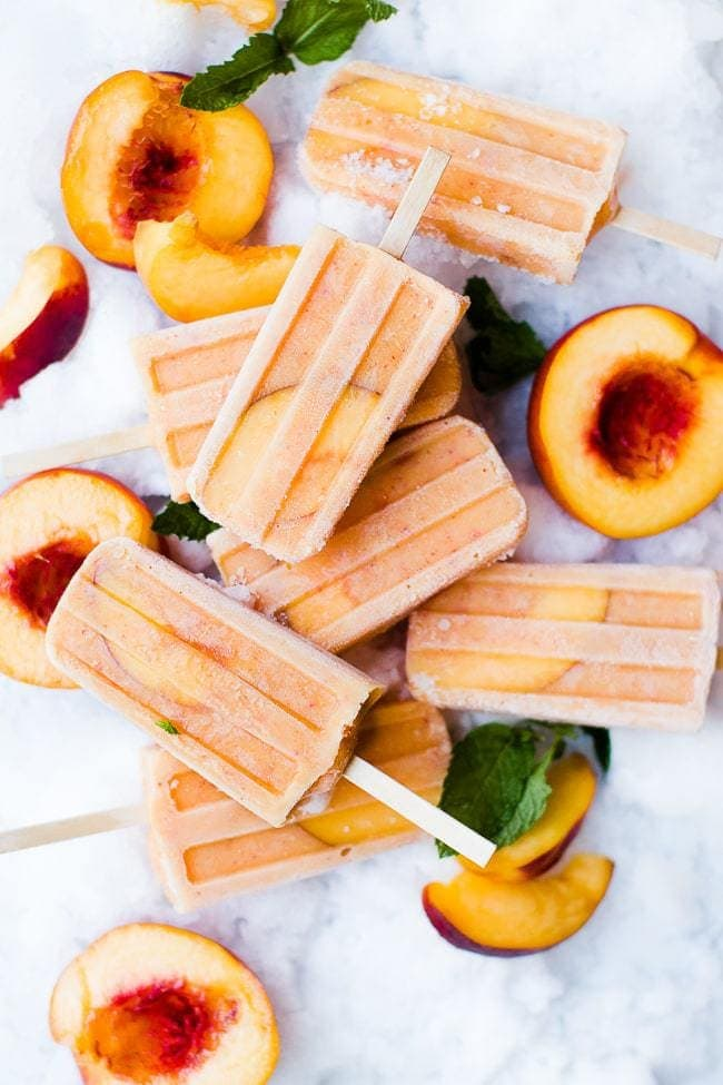 peaches and cream popsicles with fresh peaches on ice