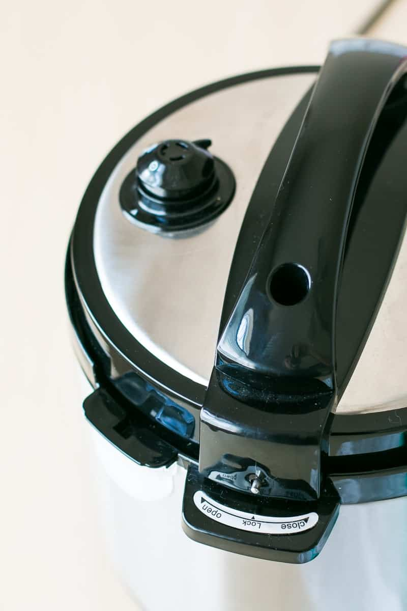 A close up of the lid of a pressure cooker