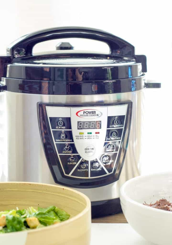 A power pressure cooker sitting on a work surface ready to make instant pot roast beef