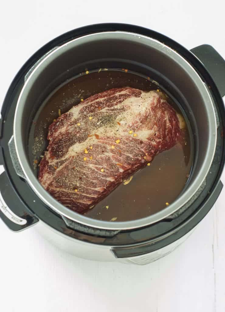 raw roast beef in a power pressure cooker