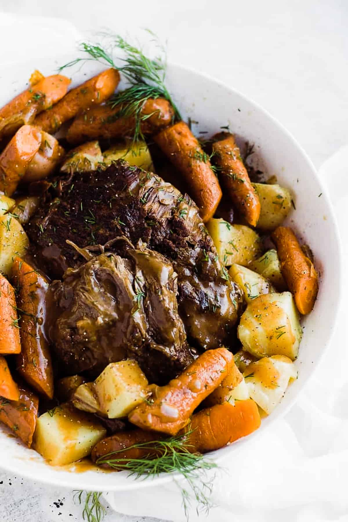 An overhead shot of instant pot Roast Beef and Potatoes in a large white serving platter